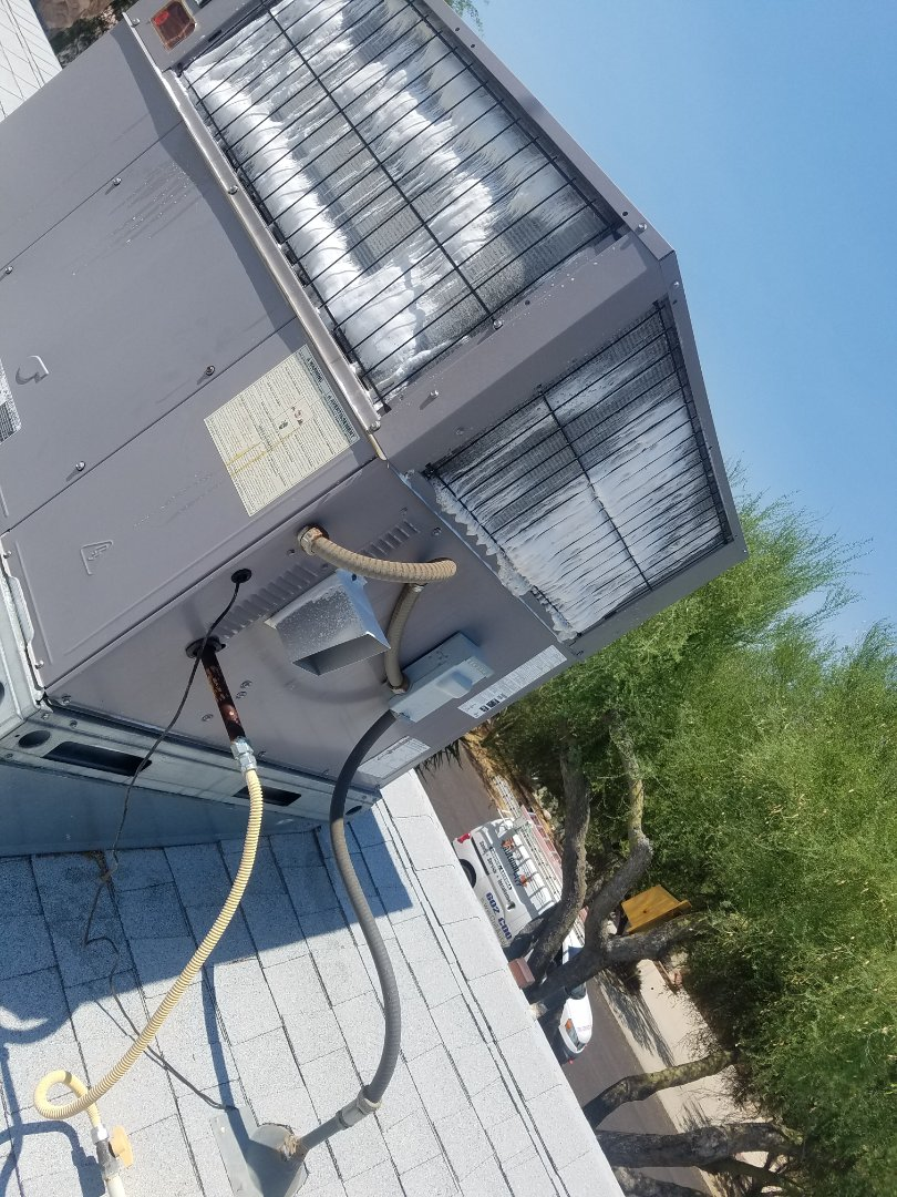 Doing a preventative maintenance tune up and a condenser coil cleaning on an air conditioner unit.