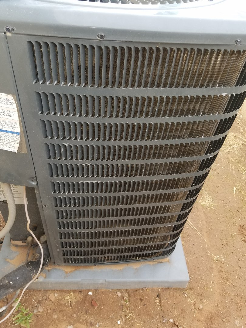 Doing a tune up on a goodman air conditioner unit and cleaning the condenser coils.