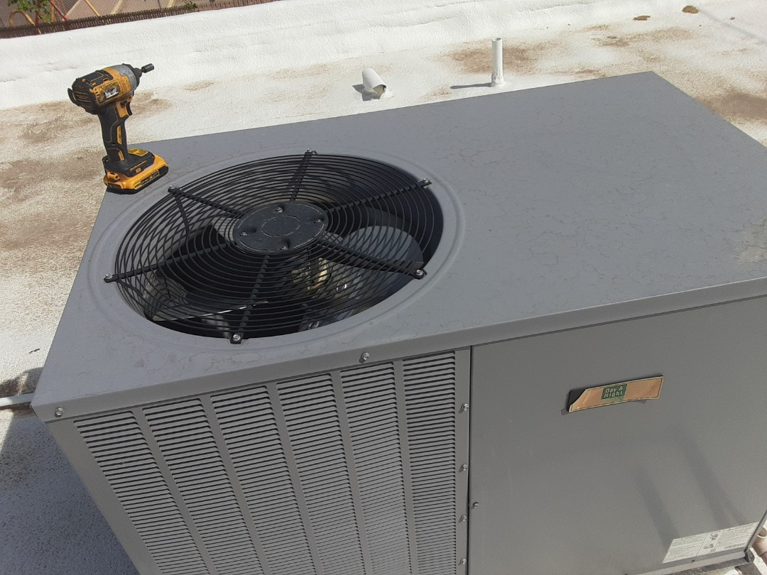 Doing a preventative maintenance tune up on a Heat pump system and cleaning the condenser coils.