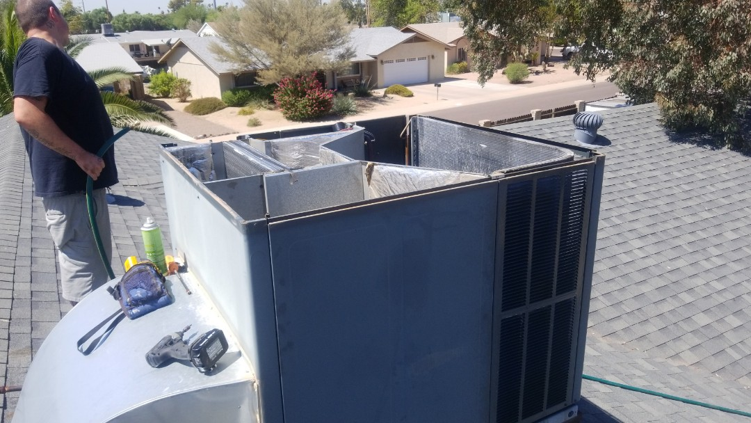 Phoenix, AZ - Working on preventive maintenance on a  Goodman Gas pack and evaporator coil and condenser coil cleaning out here in Phoenix, Arizona.