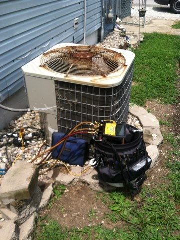 Indianapolis, IN - Repairing and servicing a Bryant air conditioner
