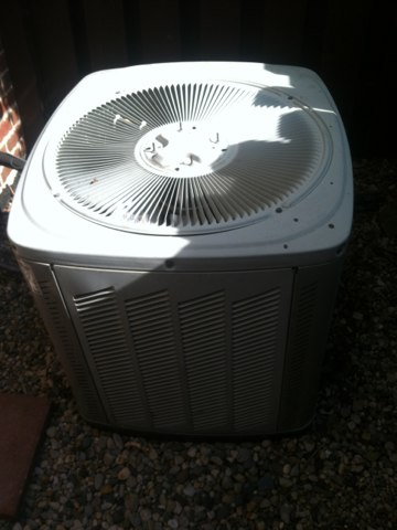 Brownsburg, IN - Servicing and repairing a Trane air conditioner
