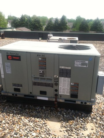 Brownsburg, IN - Servicing and repairing a Trane rooftop air conditioner