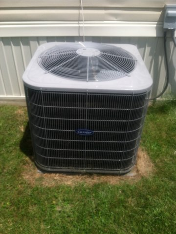 Plainfield, IN - Making repairs on a Carrierair conditioner