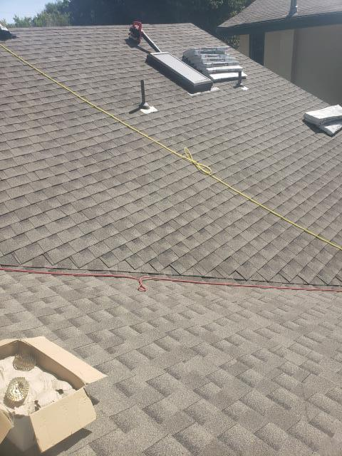 Longmont, CO - Residential roof replacement using Weathered Wood GAF Armorshield II shingles in Longmont, Colorado.