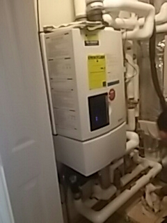 Brookline, MA - Rinnai Service. Maintenance Rinnai high efficiency water heater.