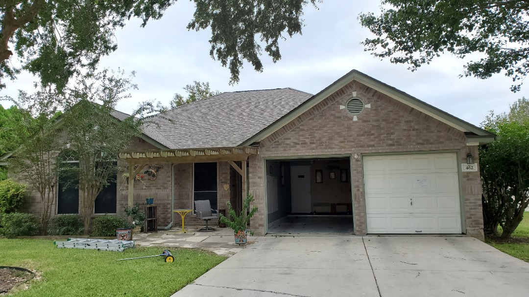 New Braunfels, TX - We installed weathered wood GAF Timberline dimensional shingles on a stunning home in New Braunfels.