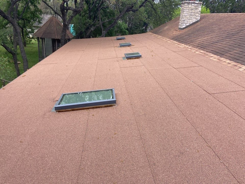 New Braunfels, TX - We installed Desert Tan Modbit and OC Duration shingles on a single story home with a beautiful property in New Braunfels.