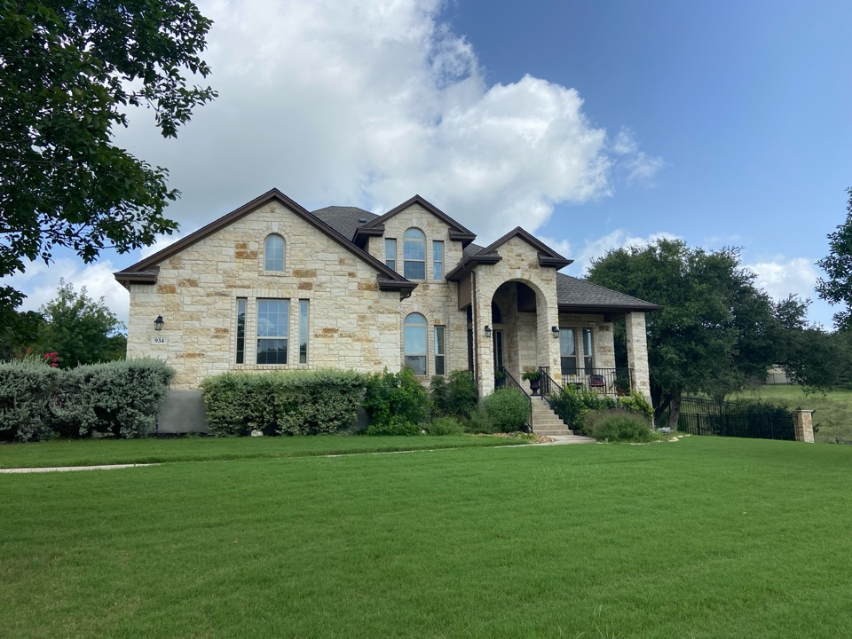 New Braunfels, TX - We installed weathered wood GAF HDZ shingles on a two story home in New Braunfels.