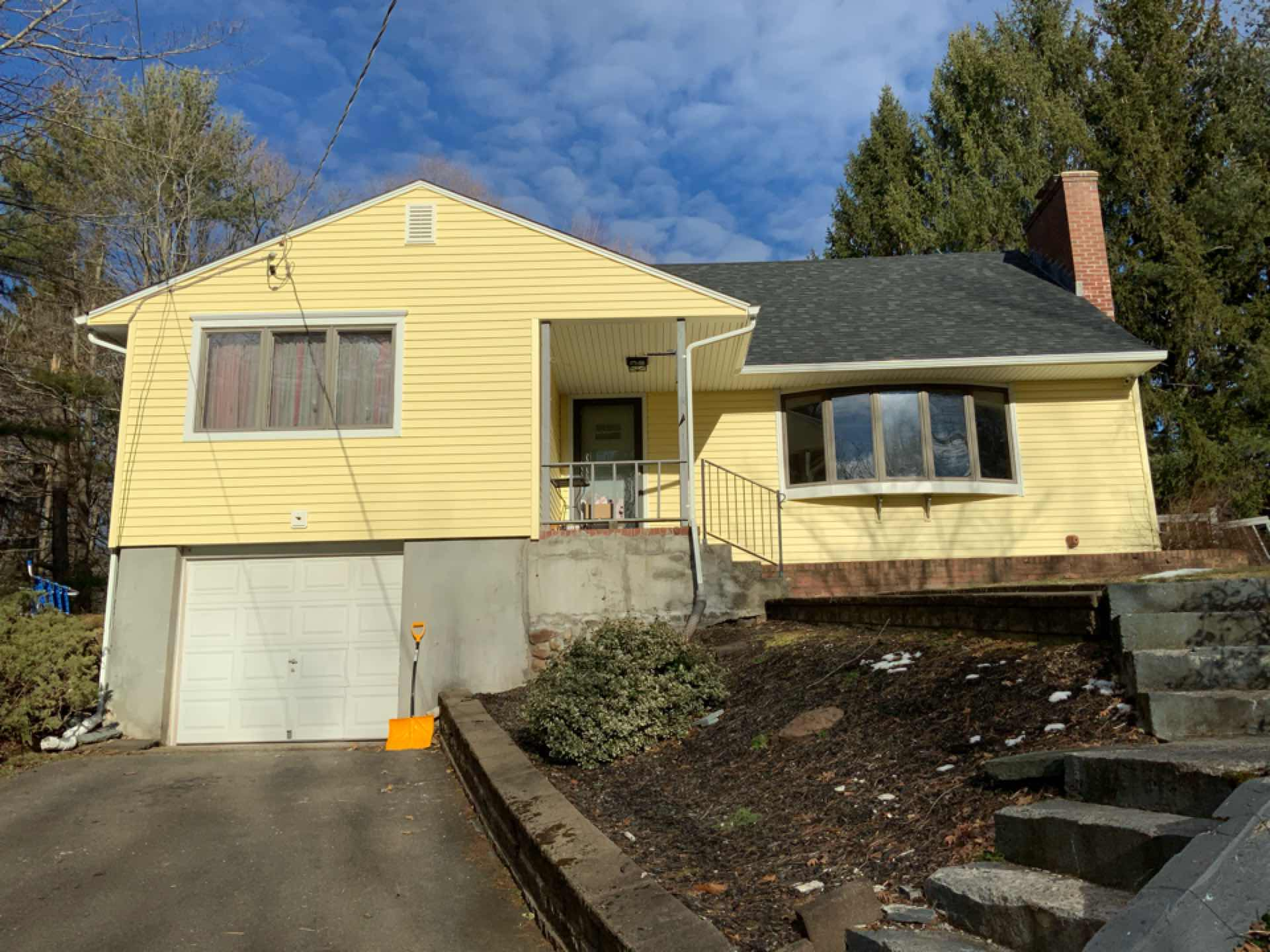 Installed beautiful new Certainteed insulated vinyl siding and seamless gutters