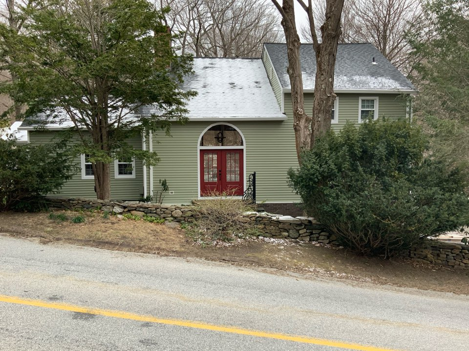 """Installed Certainteed Mainstreet double 4"""" clapboard siding, custom aluminum trim, seamless gutters and LeafBlaster gutter protection"""