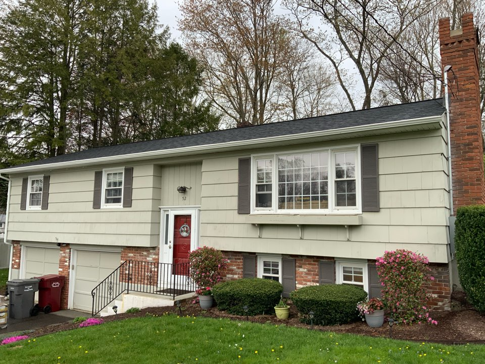Naugatuck, CT - Preparing this home for new insulated vinyl siding and trim installation