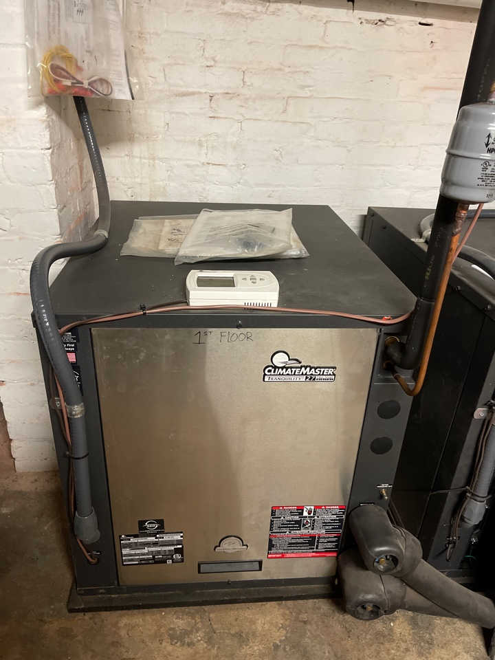 West Chester, PA - Performing maintenance on this gel-thermal and gas furnace hybrid
