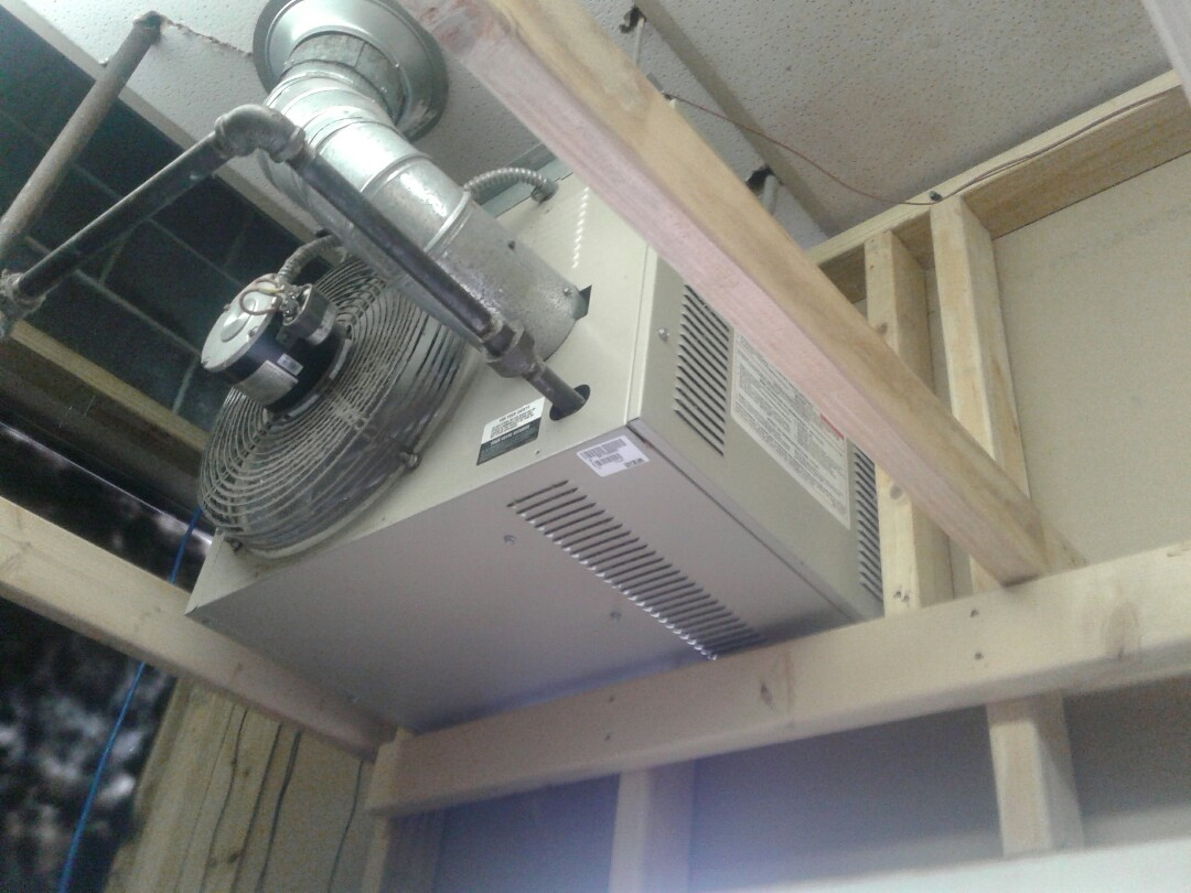Harrisonville, MO - Replace vent motor on small unit Heater in a laundry matt