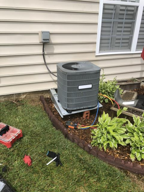 Huber Heights, OH - Customer advised had another company out the previous day. She was told she was low on refrigerant and needed new compressor. Outdoor unit was attached to frame and suspended to the house  The bracket is broken and the unit was approximately 8 inches from Being level.Was able to brace the bracket and system bringing it back to level. System was turned on and pressures checked. Pressures were well within manufactures specs. Recommend having unit moved to ground level.