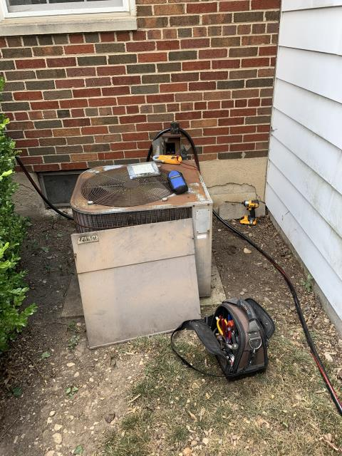 Kettering, OH - here for a no cool on approximately 35-year-old air conditioner. Unable to determine exact age due to the fact the data plate is bleached off from the sun. On arrival customer advised me that system has been running but on the hotter days it won't get below 80. Found breaker tripped to outdoor unit. Reset breaker cycled system and found compressor amps very high, as well as system very low on refrigerant. Due to age/condition customer has decided to replace system.