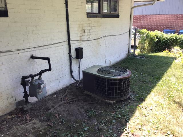 Dayton, OH - Customer decided to replace the AC unit pictured below due to age, and they are selling the home. New Carrier equipment is being installed.