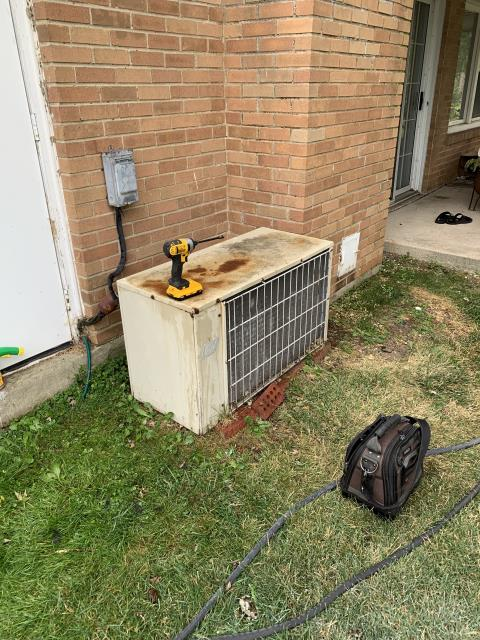 Centerville, OH - Found a trash bag stuck inside 1974 Bard AC condenser fan. Removed top and removed bag. System is very old and customer knows he is on borrowed time, but not ready for an estimate at this time. Unit operational at time of departure.