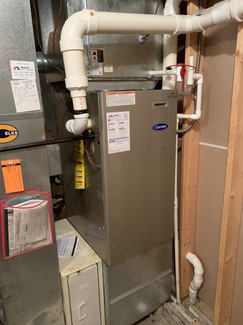 Dayton, OH - here for a no heat on a 15 year old carrier furnace. On arrival found furnace not firing up due to a pressure switch fault. Found condensate tubing and condensate trap plugged up causing water to back up into furnace. Blew out drain and also replaced two capacitors that were weak. Furnace is now operational. Explained to customer that sometimes water draining through furnace can cause other collateral failures. But everything is working as of now, doesn't appear that any electrical components got wet.