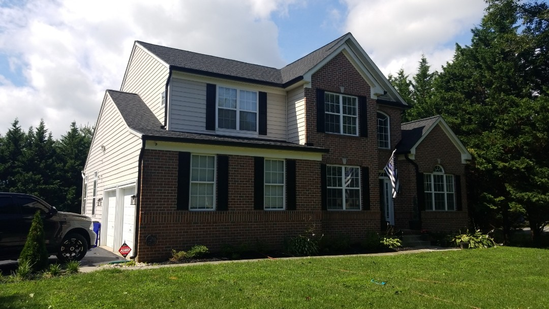 Cooksville, MD - Just finished another beautiful roof and gutter replacement. Collecting final payment and checking the job to ensure the best of quality.