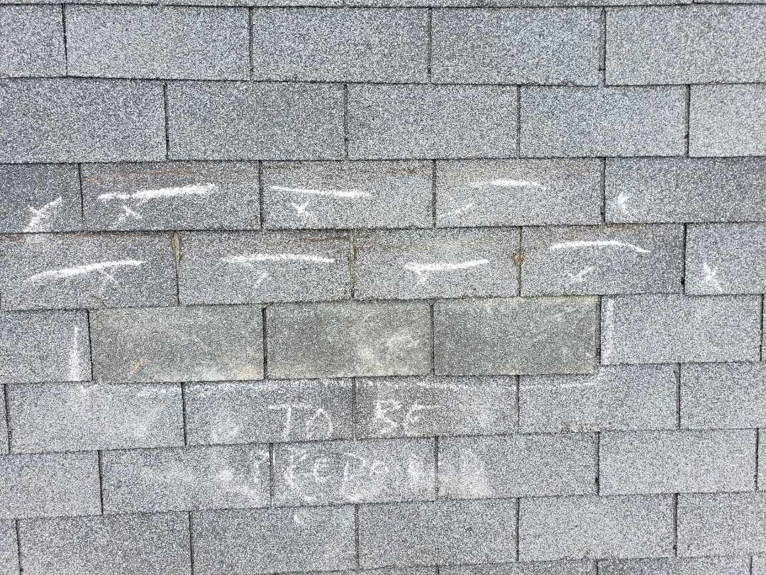 Lovettsville, VA - When we need to persuade your Insurance Company that your roof is not repairable, we go the extra mile.  A repairability test will show them the shingles become damage showing replacement is needed over repairs.