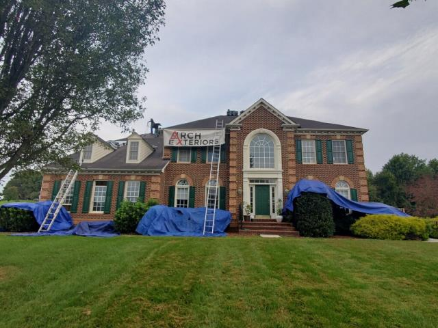 Gaithersburg, MD - We took some extra time to install protection over the landscaping for this roof replacement in Gaithersburg MD
