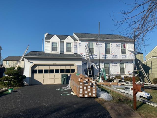 Frederick, MD - Warped roof and old siding lead this customer to a full roof and siding replacement