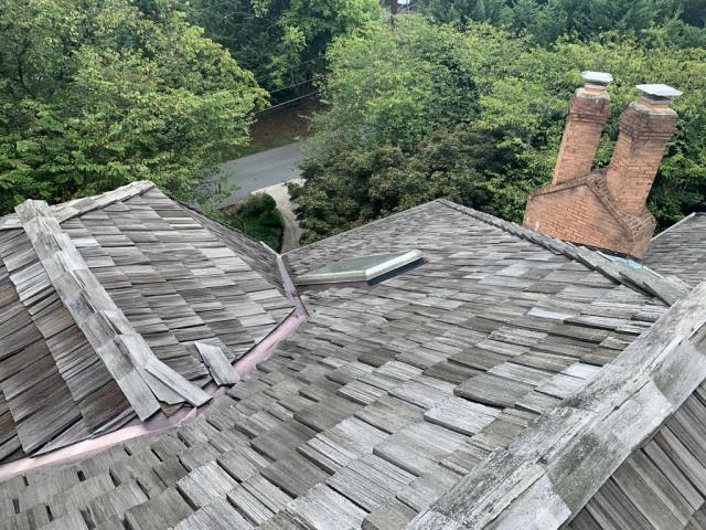 Chevy Chase, MD - Customers opted to replace their old and leaking cedar shake roof with an upgraded architectural shingle