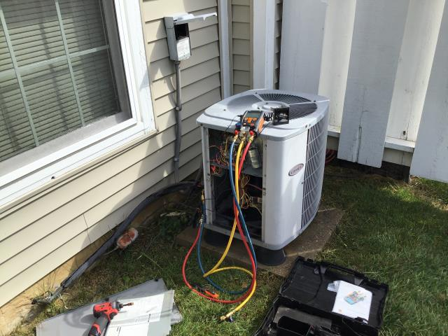 Centerville, OH - Upon service for 2001 Carrier AC, customer stated AC was not keeping temp in the residence. Outdoor unit was dirty restricting airflow. Indoor coil had visible mold growing on it. Washed outdoor unit with hose and checked pressures. Discussed options with customer and they have opted to purchase a new system.