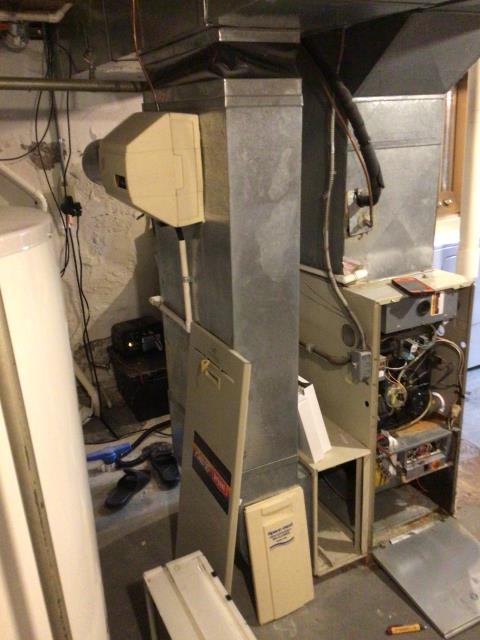 Kettering, OH - Furnace is leaking water when running. The Leek is due to a cracked collector box. Discussed options with customer and he has opted for a new furnace and AC