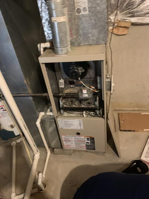 Huber Heights, OH - Fall Tune-Up on gas furnace. Replace motor surge capacitor. Replace ignitor. Un-install and clean blower motor. Re-install blower motor.