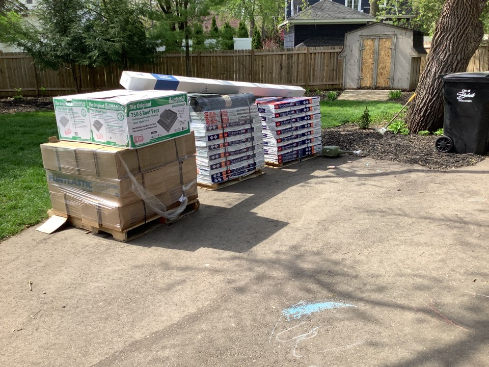 Gaf timberline Hdz shingles loaded and Ready to Roof.Also Certainteed Flintastic Cap sheet on a flat roof