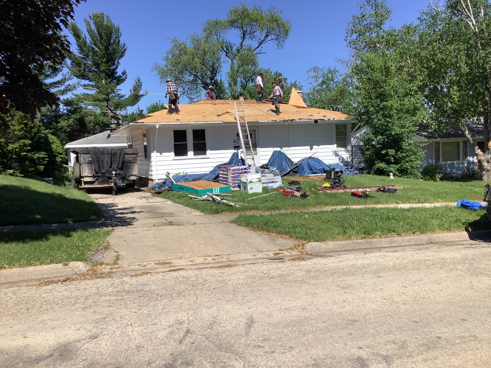 Doing a redeck in Rockford. Replacing 3/8 decking and installing  Gaf Timbrline shingles