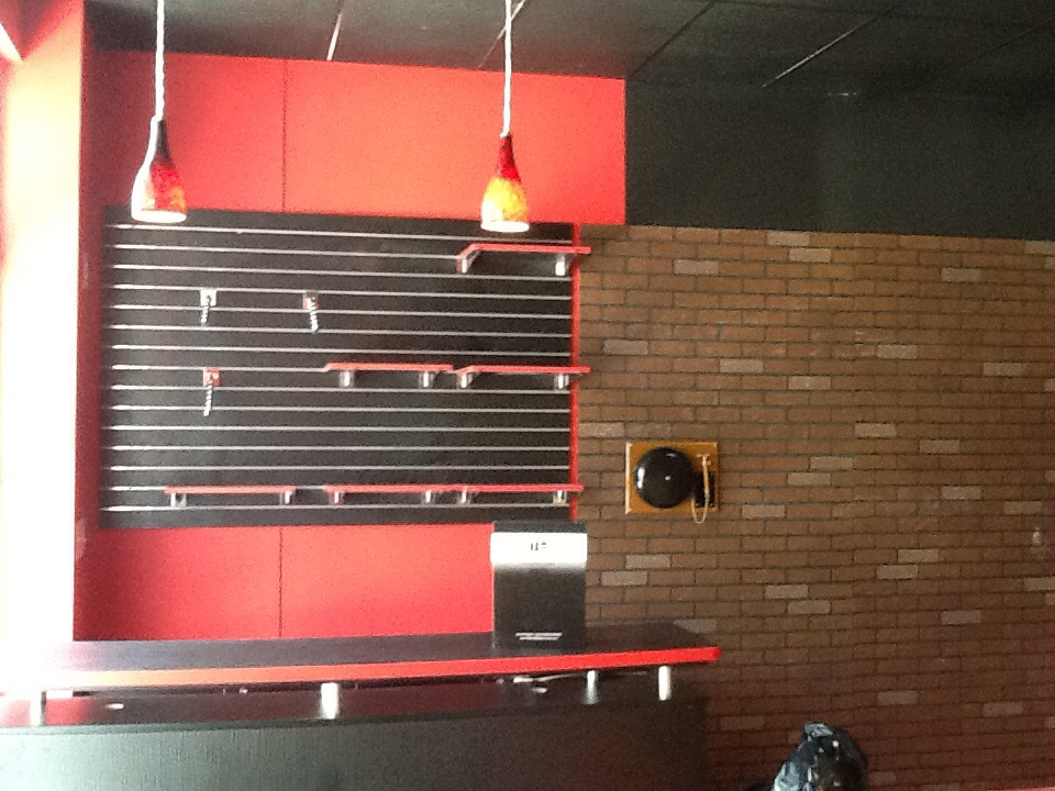 Dacula, GA - Installing new pendant lights at 9ROUND in Dacula.