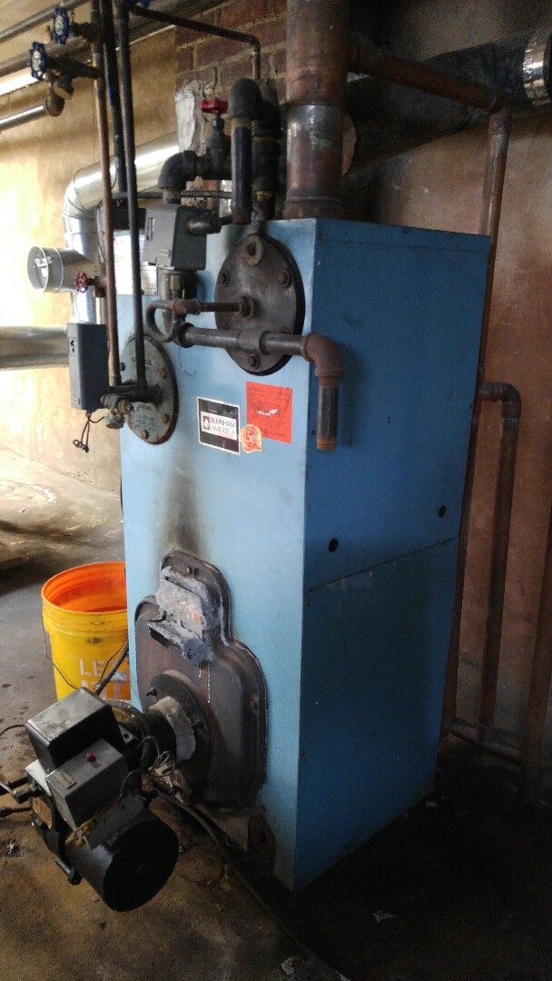 Tune up on a Burnham steam boiler.