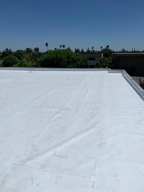 Stockton, CA - We restored this commercial property roof with a GAF single ply TPO with a 20-year material warranty.