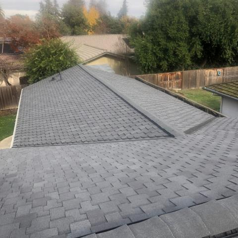 Stockton, CA - We tore off an old wood shake roof and replaced with GAF Grand Sequoia Charcoal reflector shingles. This roof looks amazing on this beautiful home. Also included was blow-in AtticCat insulation.