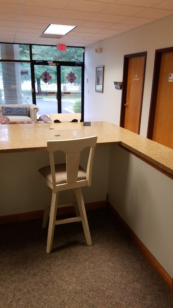 Office cleaning wiping down desk baseboards tables bathrooms office cleaning near me commercial cleaning services near me  janitorial cleaning services near me Greensboro high point summerfield Kernersville