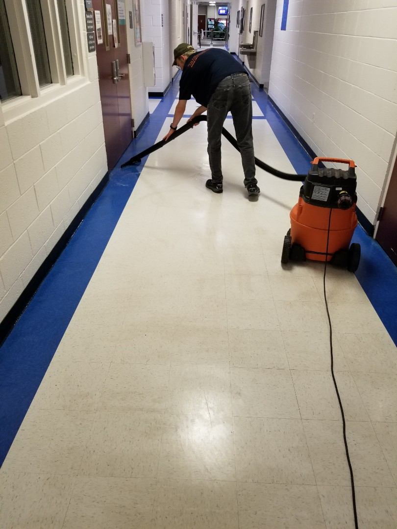 Working a strip and wax job a part of true clean experience janitorial services