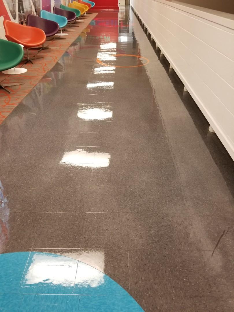Janitorial floor maintenance looking like glass