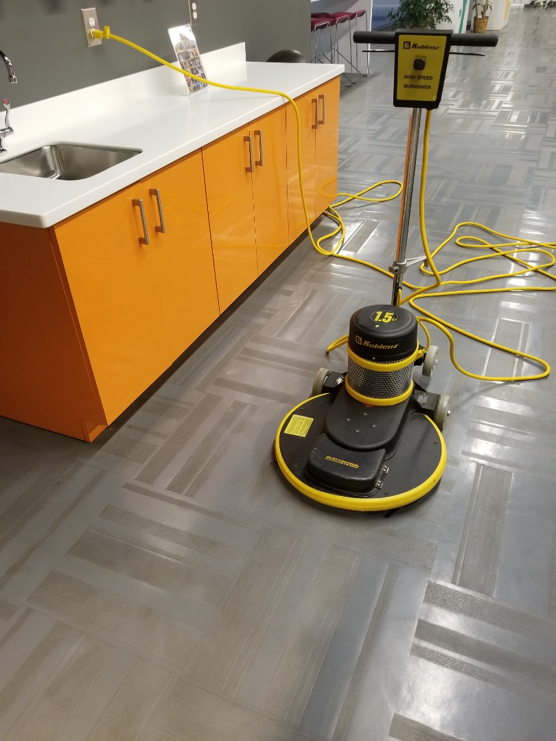 Burnishing rubber vct tile floor maintenance at a commercial site janitorial services true clean experience tce cleaning Greensboro High point Winston Salem Kernersville
