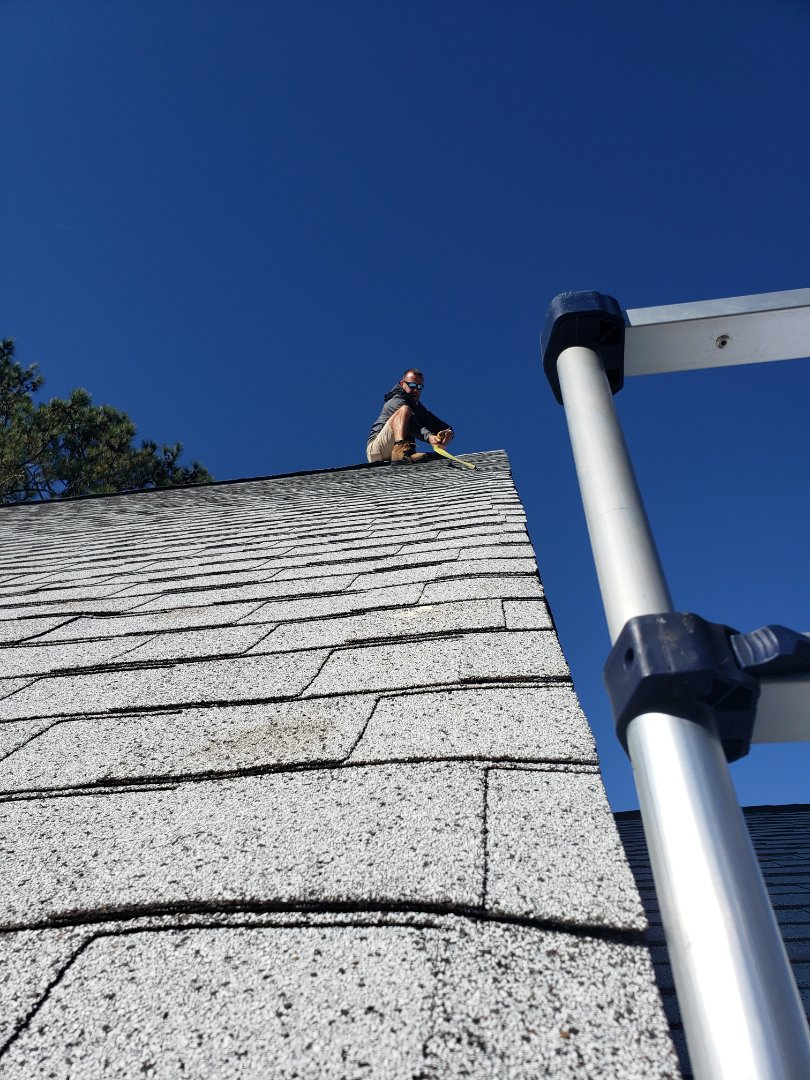 Wilmington, NC - Inspecting a roof for a customer that has a leak.