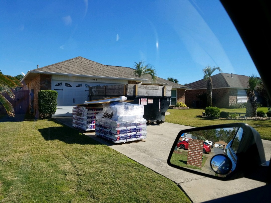 Pensacola, FL - Ready to build a new roof. Permit bag on the door, materials delivered. Are you this far with your claim yet? Does your roof still have a tarp? Are you getting the run around or delays? Give us a call, we can help. Hurricane Sally, full replacements.