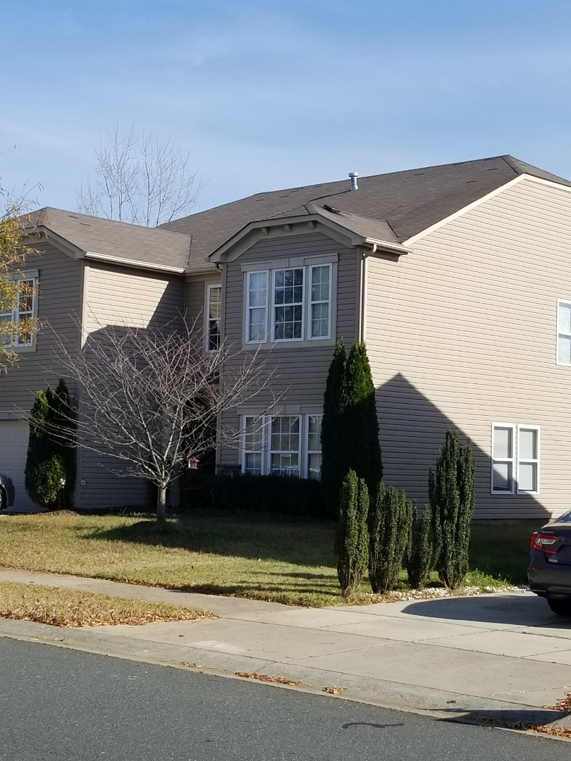 Harrisburg, NC - Aaron and Todd working wind damage claims in Charlotte area. Missing shingles? Call us for your inspection appointment.