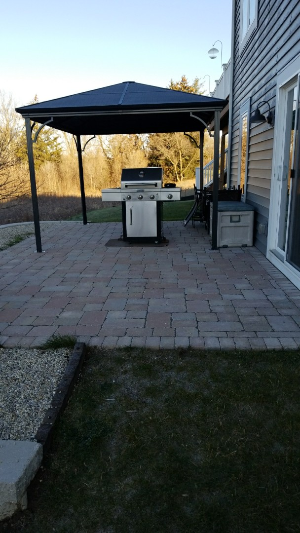 "Mukwonago, WI - Checking in on a Unilock Brussels paver patio and new landscape that included Rockwood Classic 8"" retaining wall as well as topsoil and seed.  This project was completed in the fall of 2016."