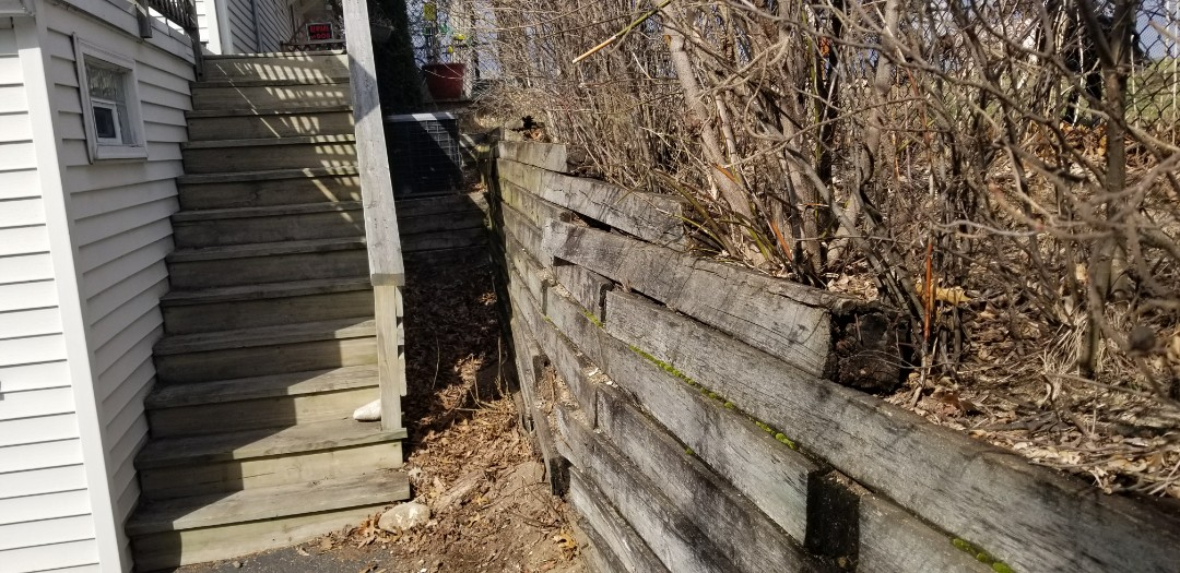 """Burlington, WI - Just meet with a client who is in need of their timber retaining wall replaced.  This failing timber wall will be replaced with Rochester Concrete Products (RCP) Classic 8"""" Retaining wall block."""