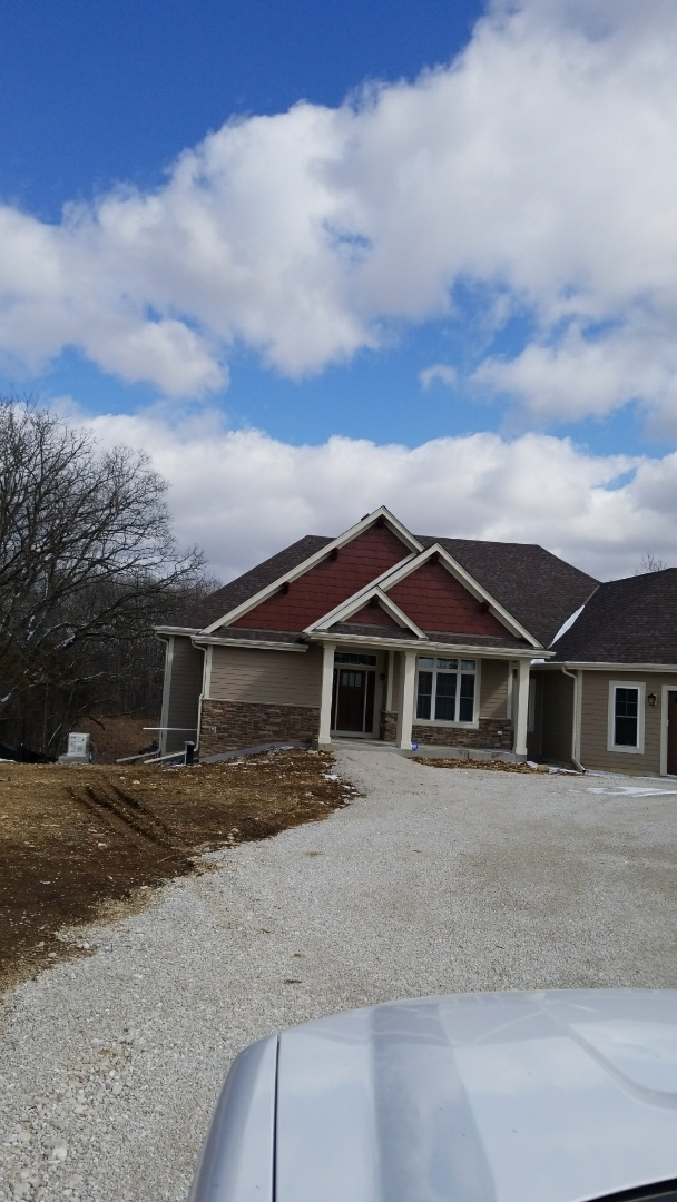 Burlington, WI - Meet with clients who just finished this new construction home in Burlington,  Wi and they are looking for having a lawn installed using hydroseeding.