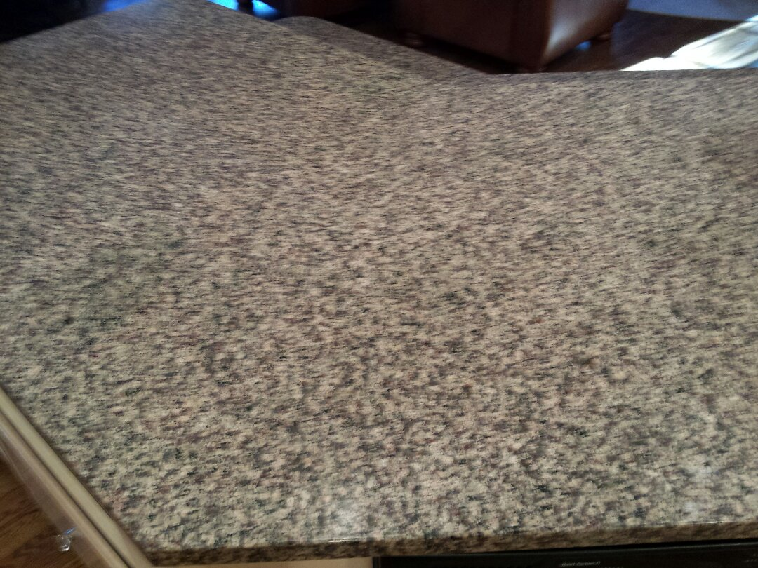 This granite counter top looks amazing after we cleaned and sealed it!