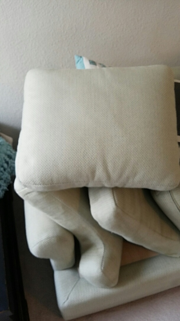 This cushion used to be the proud owner of a large piece of melted chocolate! This customer couldn't believe her eyes!