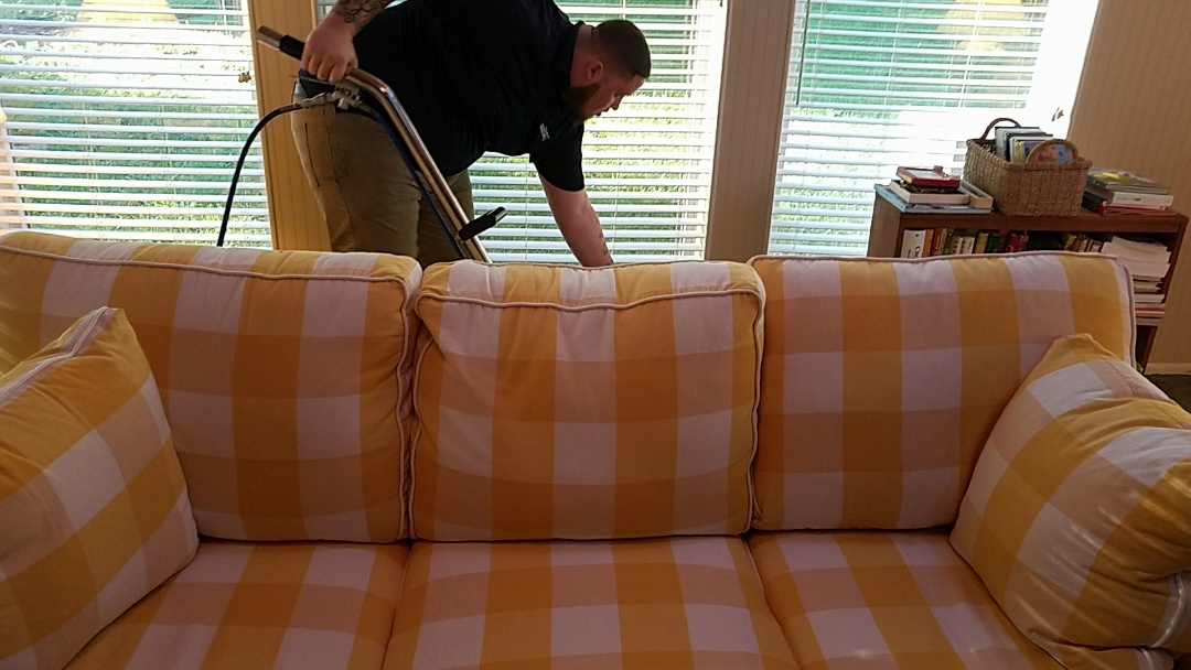 """Richmond, VA - While cleaning this families sofa our technician noticed some cobwebs and dust behind the sofa. Unprompted he immediately went behind the sofa and cleaned all that """"unwanted"""" stuff out of their house. Nice job!"""